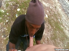 Young brown gay sucks white cock outdoor
